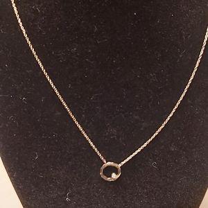 Silpada orbiting moon pendant on a chain